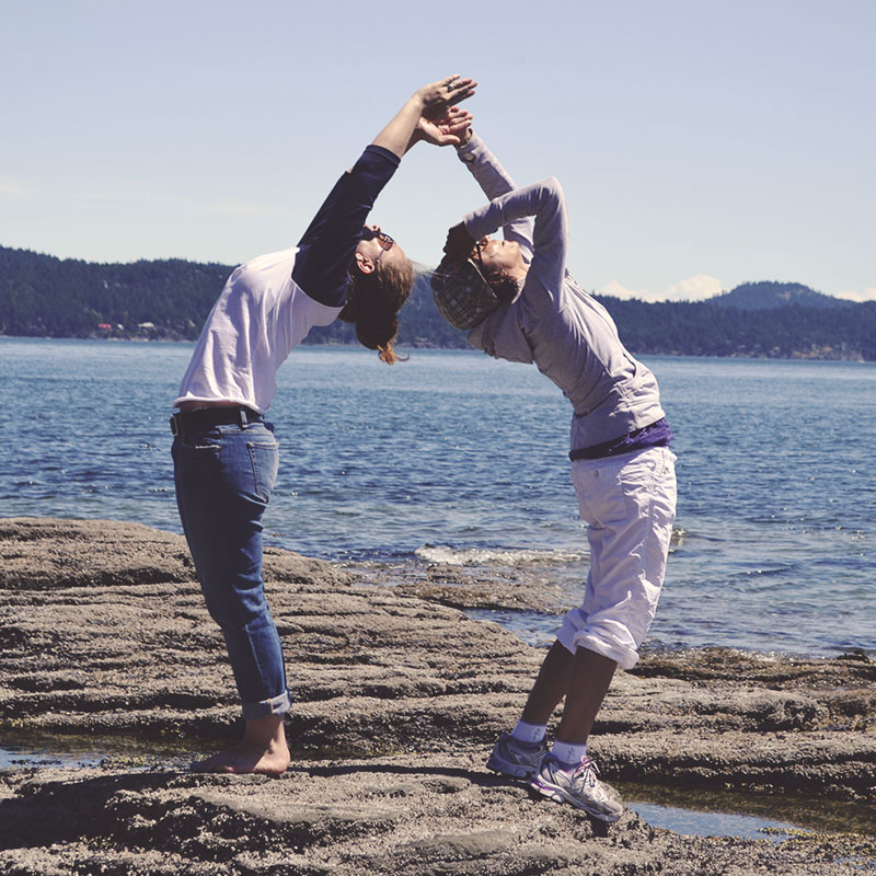 yoga friends on beach